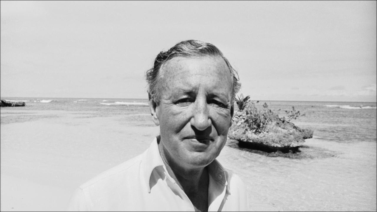 British novelist Ian Fleming (1908 - 1964) on the beach near Goldeneye, his Jamaica home, 23rd February 1964. (Photo by Harry Benson/Express/Getty Images)