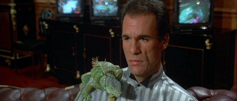 Robert Davi as Franz Sanchez with his diamond-chained iguana in Licence To Kill (1989)