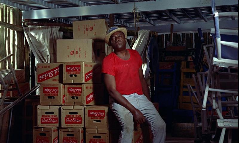 Boxes of Jamaica's signature Red Stripe beer surround Quarrel in Dr. No (1962)