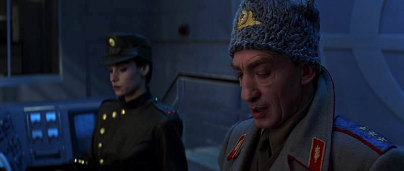 Xenia Onatopp (played by Famke Janssen) and General Ourumov (played by Gottfried John) arm the GoldenEye satellite in GoldenEye (1995)