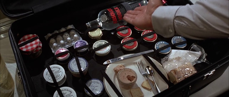 Sean Connery as James Bond showcases the contents of his kit in Never Say Never Again (1983)