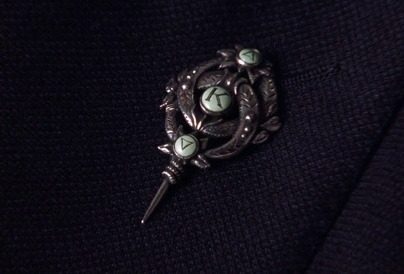 Sir Robert King's lapel pin that acted as a detonator and killed him in The World Is Not Enough (1999)