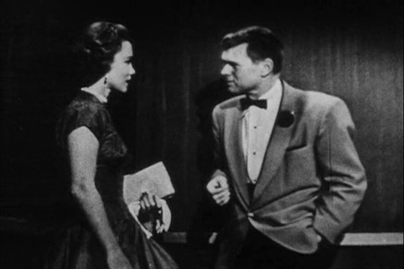 "Linda Christian as Valerie Mathis and Barry Nelson as James Bond in the unofficial Bond movie <a href=""http://www.bondmovies.com/crtv/"">Casino Royale</a> (TV - 1954)"