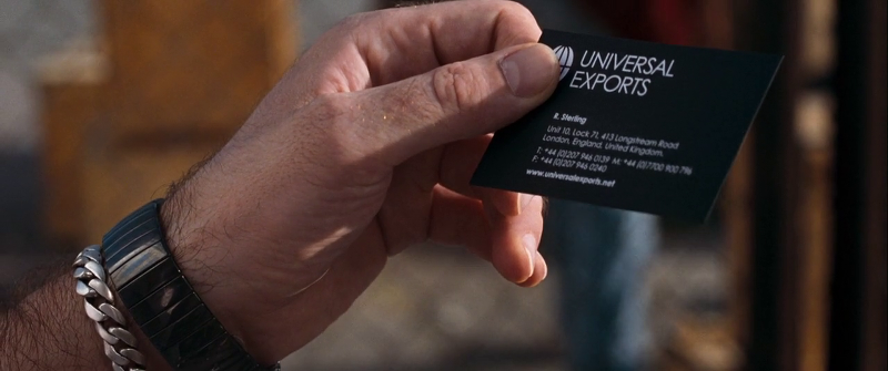 Bond hands over his UnivEx business card to Dominic Greene's goon when trying to meet with Greene