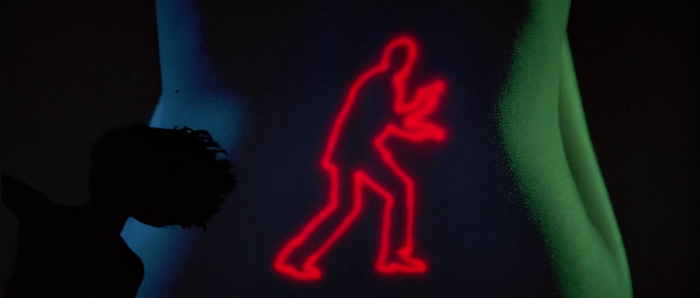 The Roger Moore silhouette projected on a woman's back in the title sequence of Octopussy (1983)