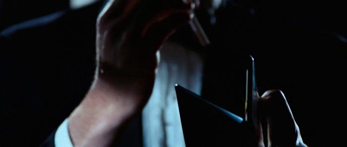 James Bond (George Lazenby) lights up at the beginning of On Her Majesty's Secret Service (1969)