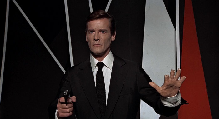 A statue of James Bond (Roger Moore) has its hands shot by Scaramanga in The Man with the Golden Gun (1974)
