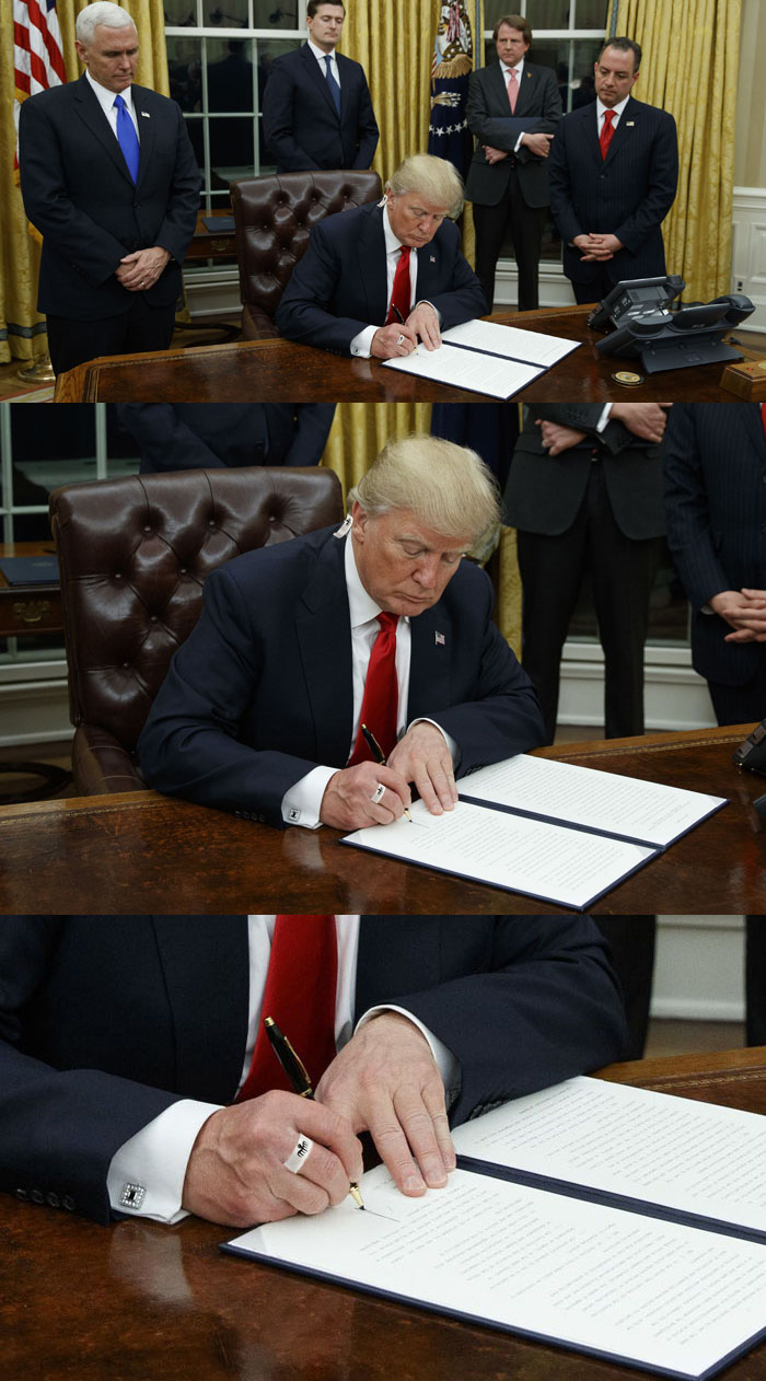 President Donald Trump apparently wearing a Spectre ring during the signing of an executive order