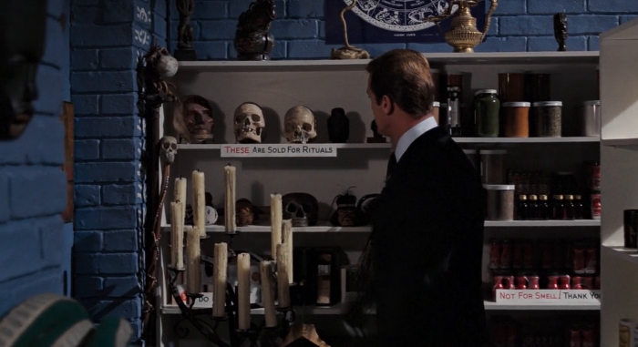 James Bond (Roger Moore) peruses the Oh Cult Voodoo Shop in Live and Let Die (1973)