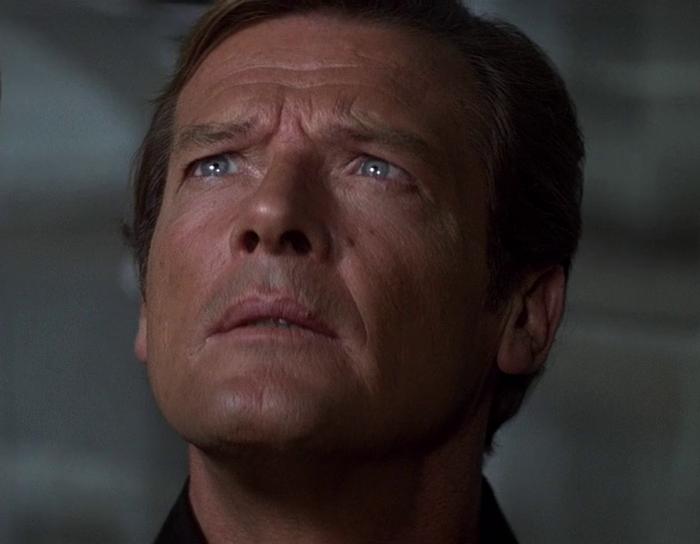 James Bond (Roger Moore) in Moonraker (1979) admires Roger Deakin's cinematography in Skyfall (2012)