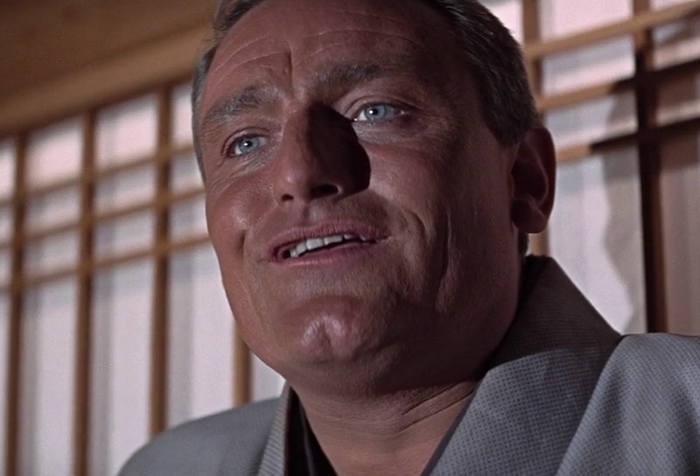 Dikko Henderson (Charles Gray) calmly reacts to being stabbed in the back in You Only Live Twice (1967)