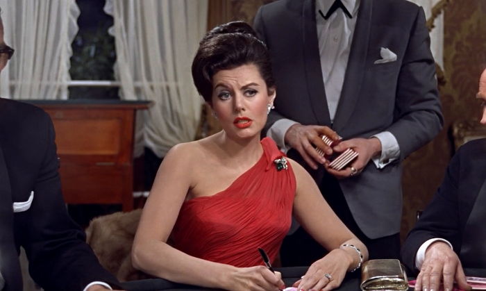 Sylvia Trench (Eunice Gayson) looks at James Bond, and the guy dancing, peculiarly in Dr. No (1962)