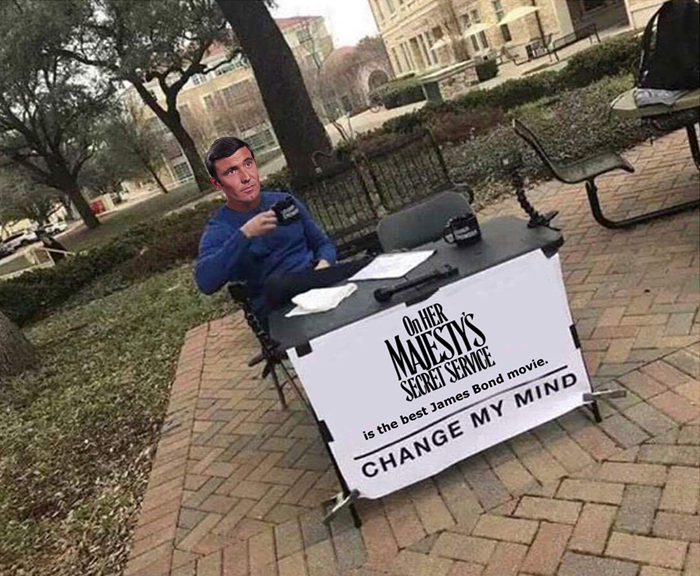 George Lazenby advocates for On Her Majesty's Secret Service (1969) in the form of the Change My Mind meme